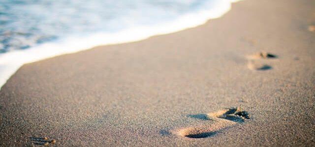 footsteps in beach